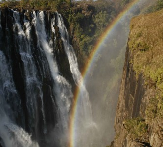 Rainbow at the Victoria Falls. Photo copyright by Ian Dove